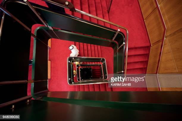A general view shows a lift system and stairwell allowing guests to move between the 13 decks aboard The Queen Elizabeth II luxury cruise liner also...