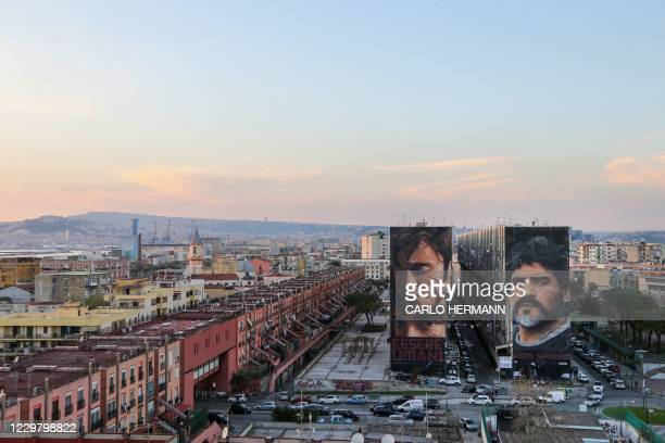 General view shows a mural of late Argentinian football legend Diego Maradona on November 26, 2020 in Naples. - Maradona, widely remembered for his...