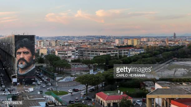General view shows a mural of late Argentinian football legend Diego Maradona on November 26, 2020 in Naples, southern Italy. - Maradona, widely...
