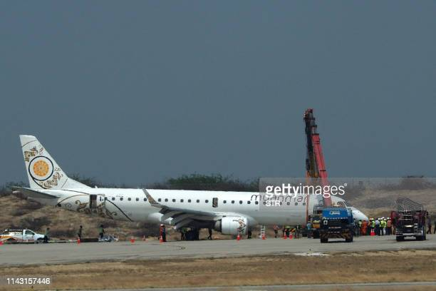 General view shows a Myanmar National Airlines passenger plane after an emergency landing at Mandalay international airport on May 12, 2019. - A...
