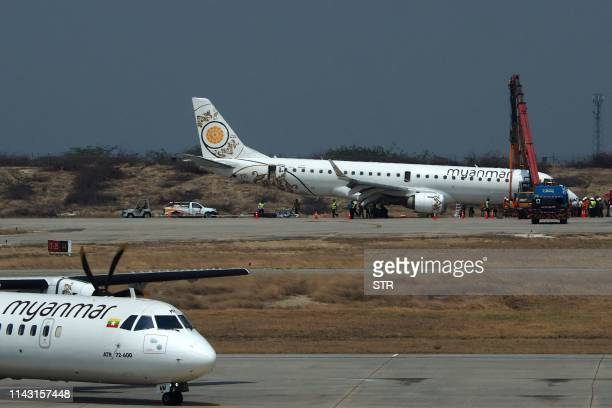A general view shows a Myanmar National Airlines passenger plane after an emergency landing at Mandalay international airport on May 12 2019 A...