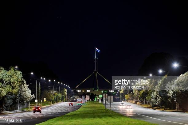 General view shows a near-empty road around Parliament House in Canberra on August 12 as Australia's capital was ordered into a seven-day lockdown...