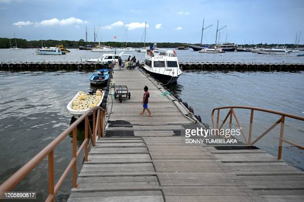 General view shows a pier in Denpasar on Indonesia's resort island of Bali on March 8 from which fast boats travel to Nusa Penida island.