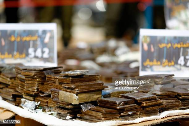 A general view shows a pile of confiscated bars of hashish seized since the beginning of the year before they were burnt in Gaza City on May 11 2017...