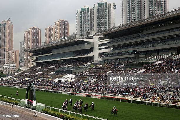 A general view shows a race during the QEII Cup horse racing event at Sha Tin race course in Hong Kong on April 24 2016 / AFP / ISAAC LAWRENCE