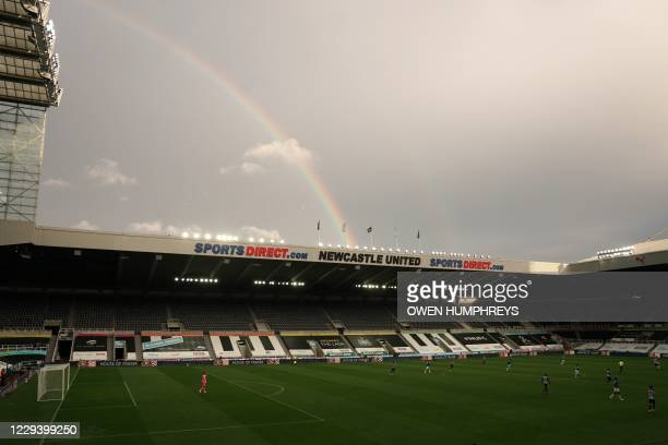 General view shows a rainbow overhead during the English Premier League football match between Newcastle United and Everton at St James' Park in...