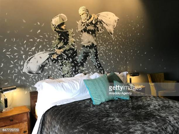A general view shows a room at Banksy's newly opened 'The Walled Off' hotel next to the controversial Israeli separation wall in the West Bank town...