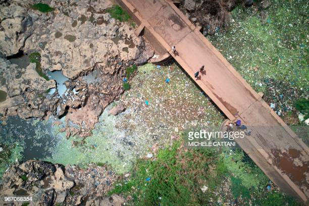 A general view shows a section of the Niger river in Bamako clogged with plastic waste and other polluting materials on June 2 2018 On June 5 2018...