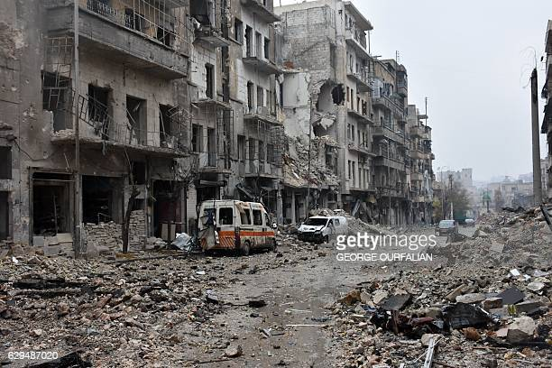 A general view shows a severely damaged street in Aleppo's AlKalasseh neighbourhood in the eastern part of the war torn city on December 13 2016...