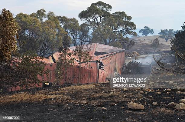 A general view shows a shed destroyed during bushfires in Upper Hermitage in the Adelaide Hills on January 3 2015 Houses were lost as an intense...