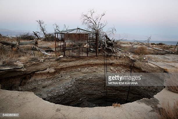A general view shows a sinkhole in Israel's abandoned tourist resort of Ein Gedi on the shore of the Dead Sea on July 11 2016 Experts have warned...