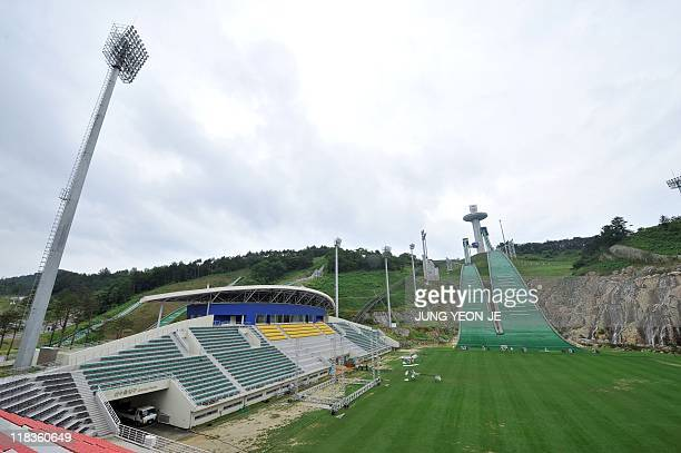 A general view shows a ski jump stadium in South Korea's mountain resort of Pyeonchang 180 kms east of Seoul on July 7 2011 after the mountain resort...