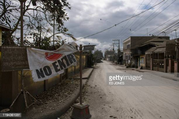 A general view shows a street covered with ash from the Taal volcano eruption near Laurel on Janaury 18 2020