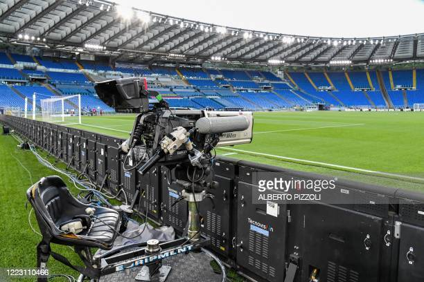 General view shows a television broadcast camera and empty tribunes prior to the Italian Serie A football match Lazio vs Fiorentina played on June...