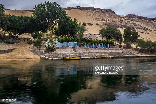 A general view shows a traditional building on the bank of the Nile River in Aswan 900 kilometres south of the capital Cairo on March 13 2016 / AFP /...