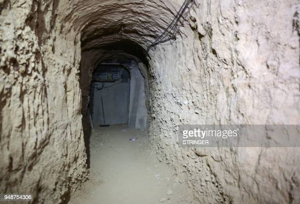A general view shows a tunnel leading to an abandoned prison used by Jaish alIslam fighters in the former rebelheld Syrian town of Douma on the...