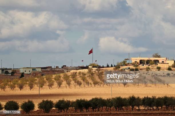 A general view shows a Turkish flag fluttering at a military post in the village of Ashma in the Kurdish region of Kobane in northern Syria on...