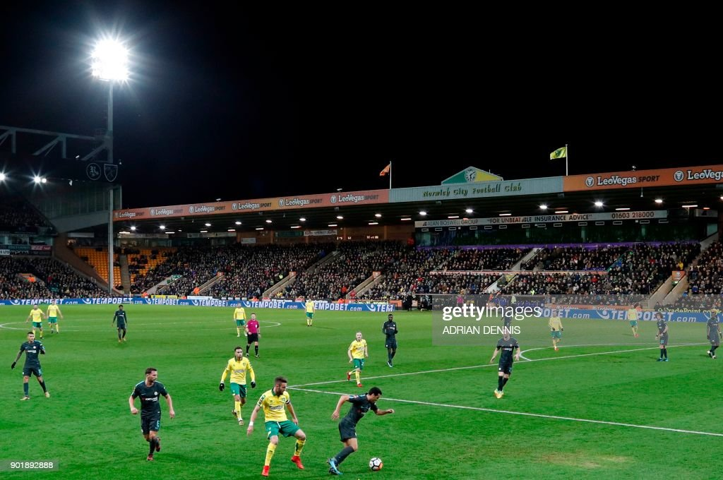 A general view shows action during the English FA Cup third round football match between Norwich City and Chelsea at Carrow Road in Norwich, north east England on January 6, 2018. / AFP PHOTO / Adrian DENNIS / RESTRICTED TO EDITORIAL USE. No use with unauthorized audio, video, data, fixture lists, club/league logos or 'live' services. Online in-match use limited to 75 images, no video emulation. No use in betting, games or single club/league/player publications. /
