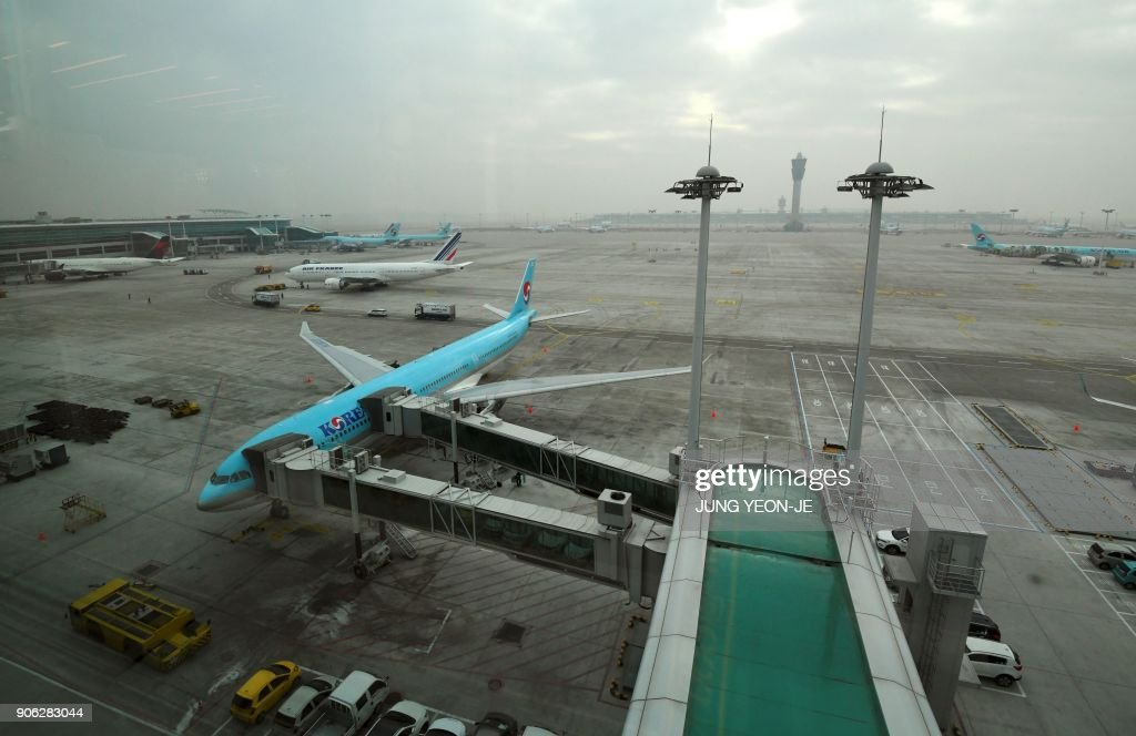A general view shows airplanes sitting on the tarmac at Terminal 2 of Incheon International Airport, west of Seoul, on January 18, 2018. Incheon airport, South Korea's top gateway, on January 18 opened its second terminal, three weeks before the opening of the Pyeongchang Olympics, airport authorities said. Terminal 2 houses four airlines -- South Korea's flag carrier Korean Air, Air France, Delta, and KLM Royal Dutch Airlines.