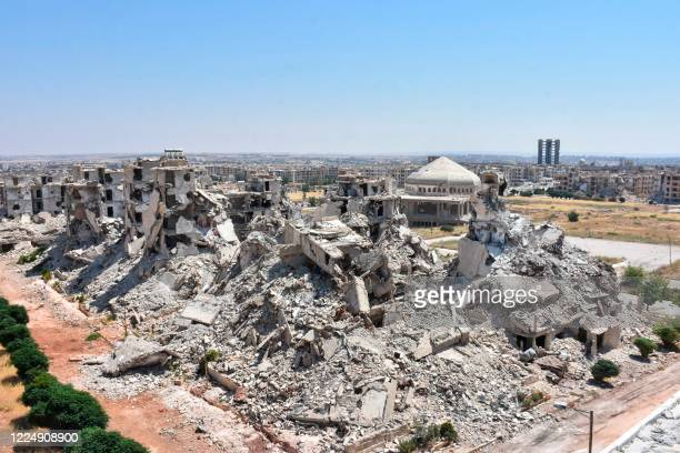 General view shows al-Zahraa neighbourhood of Aleppo destroyed following years of conflict in Syria, on July 6, 2020. - Syria's war since 2011 has...