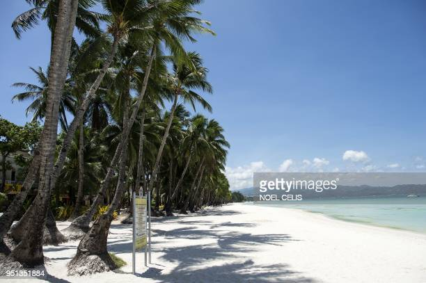 A general view shows an empty beach on the Philippine island of Boracay on April 26 2018 The Philippines shuttered its most famous holiday island...