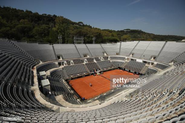 General view shows an empty central court as Canada's Felix Auger-Aliassime serves to Serbia's Filip Krajinovic on day one of the Italian Open at...