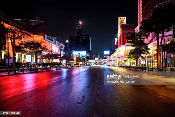 A general view shows an empty street in Bangkok on April 3 ahead of a nationwide night curfew aimed at stemming the spread of the COVID19 novel...