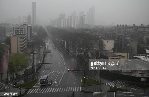 General view shows an empty street in Wuhan, China's central Hubei province on March 8, 2020. - China on March 8 reported its lowest number of new...