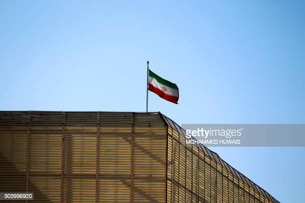 A general view shows an Iranian national flag on top of the Iranian embassy in the Yemeni capital Sanaa on January 8 2016 A day earlier Iran said it...