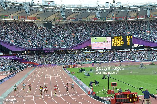 General view shows athletes competing in the women's 100m final at the athletics event of the London 2012 Olympic Games on August 4 2012 in London...