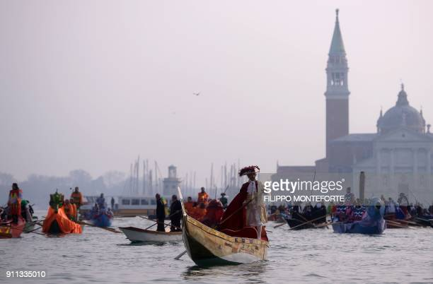 A general view shows boats on the Grand Canal during the opening regatta of the Venice Carnival on January 28 2018 / AFP PHOTO / FILIPPO MONTEFORTE