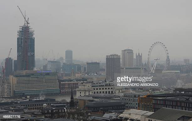 A general view shows buildings in central London on March 19 2015 A toxic air pollution cloud blew over Britain on Thursday causing potential health...