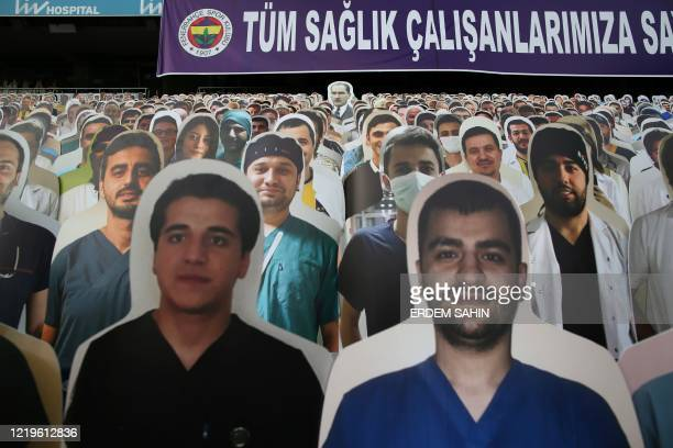 General view shows cardboards with one picture of Mustafa Kemal Ataturk , founder of modern Turkey, and photographs of medical staff on the stands in...