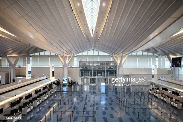 General view shows check-in counters at the departure hall of Tokyo's Haneda Airport is seen on March 10, 2020. - Japan's government March 10...