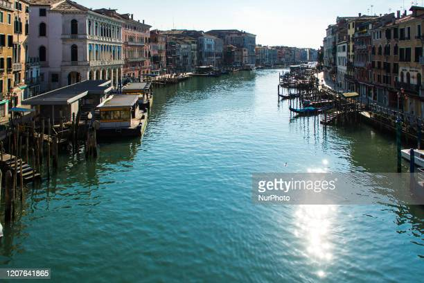 General view shows clear waters of the Grand Canal near the Rialto Bridge in Venice on March 18 as a result of the stoppage of motorboat traffic,...