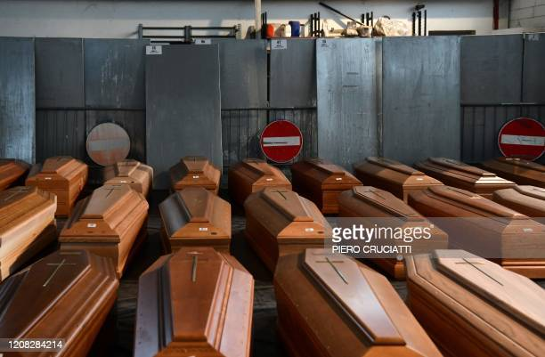 General view shows coffins of deceased people stored in a warehouse in Ponte San Pietro, near Bergamo, Lombardy, on March 26, 2020 prior to be...