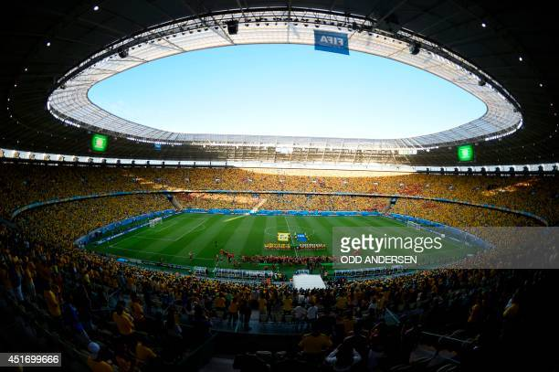A general view shows Colombia's and Brazil's players posing before the quarterfinal football match between Brazil and Colombia at the Castelao...