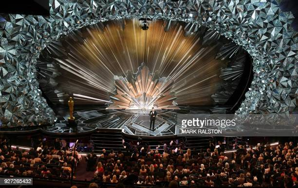 A general view shows comedian Jimmy Kimmel delivering a speech during the opening of the 90th Annual Academy Awards show on March 4 2018 in Hollywood...