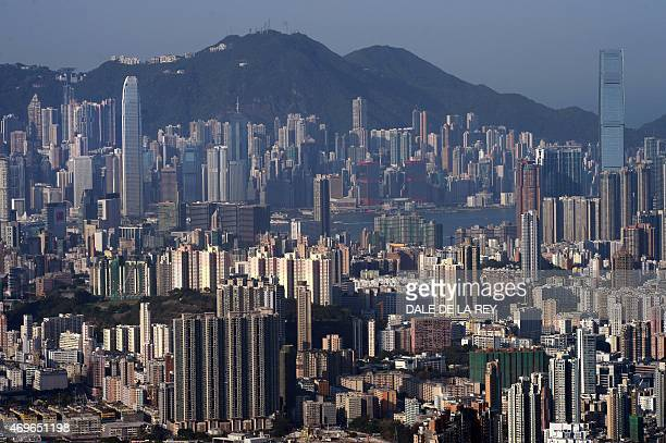 A general view shows commercial and residential buildings in Hong Kong on April 14 2015 AFP PHOTO / DALE DE LA REY