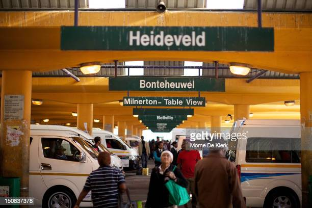 A general view shows commuters and taxis in the biggest and busiest taxi rank in the Western Cape the central taxi rank on August 03 2012 in Cape...