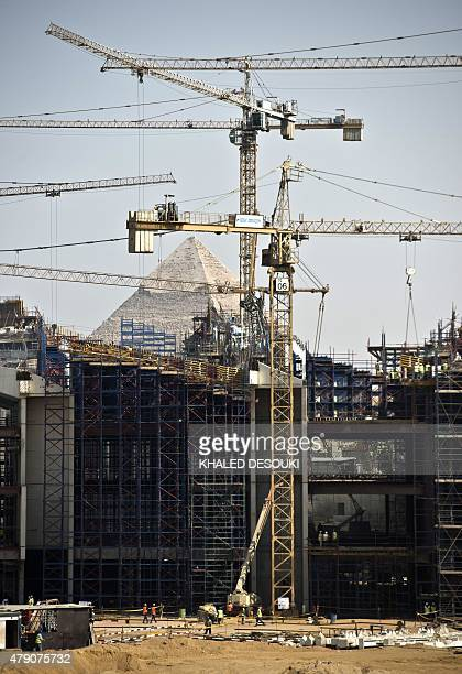 General view shows construction at the new Grand Egyptian Museum near the Giza pyramids in Cairo on June 4, 2015. Hundreds of artefacts, never before...
