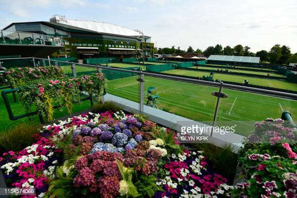 A general view shows courts and flower displays before play at The All England Tennis Club in Wimbledon southwest London on July 8 on the seventh day...