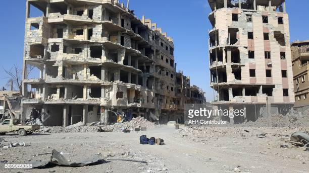 A general view shows damaged buildings in the eastern Syrian city of Deir Ezzor on November 3 2017 The Islamic State jihadist group lost control of...