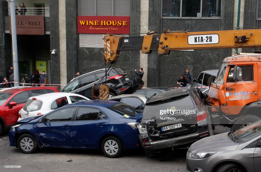 A general view shows damaged cars at the site of a mass road