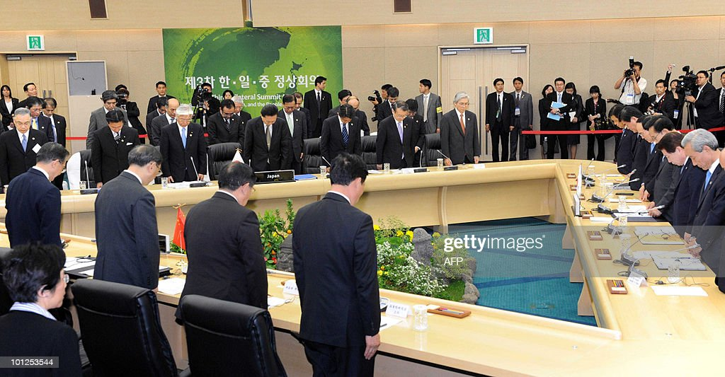 A general view shows delegates at the South Korea, Japan, China trilateral summit bowing before the talks commence in Seogwipo, on May 29, 2010. China came under intensified pressure from South Korea and Japan to join global efforts to punish North Korea over the sinking of a South Korean warship in March.