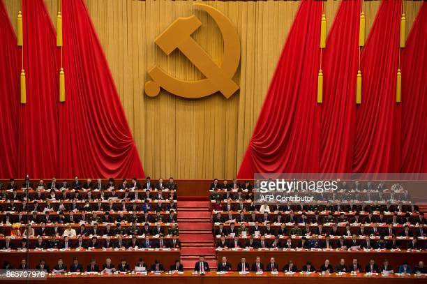 General view shows delegates attending the closing of the 19th Communist Party Congress at the Great Hall of the People in Beijing on October 24,...