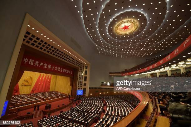 General view shows delegates attending the opening of the 19th Communist Party Congress at the Great Hall of the People in Beijing on October 18,...
