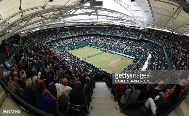 General view shows Denis Kudla from the US playing against Roger Federer of Switzerland during their match at the ATP tennis tournament in Halle,...
