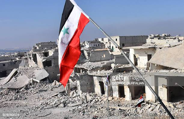 A general view shows destroyed buildings in Aleppo's Sheikh Saeed district on December 12 after Syrian progovernment forces retook the area from...
