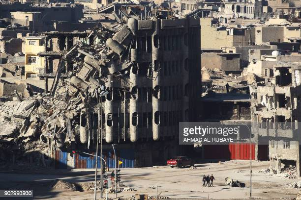 A general view shows destroyed buildings in Mosul on January 8 six months after Iraqi forces seized the country's second city from Islamic State...